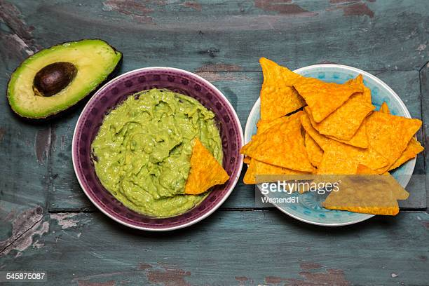 Guacamole, sliced avocado and tortilla chips