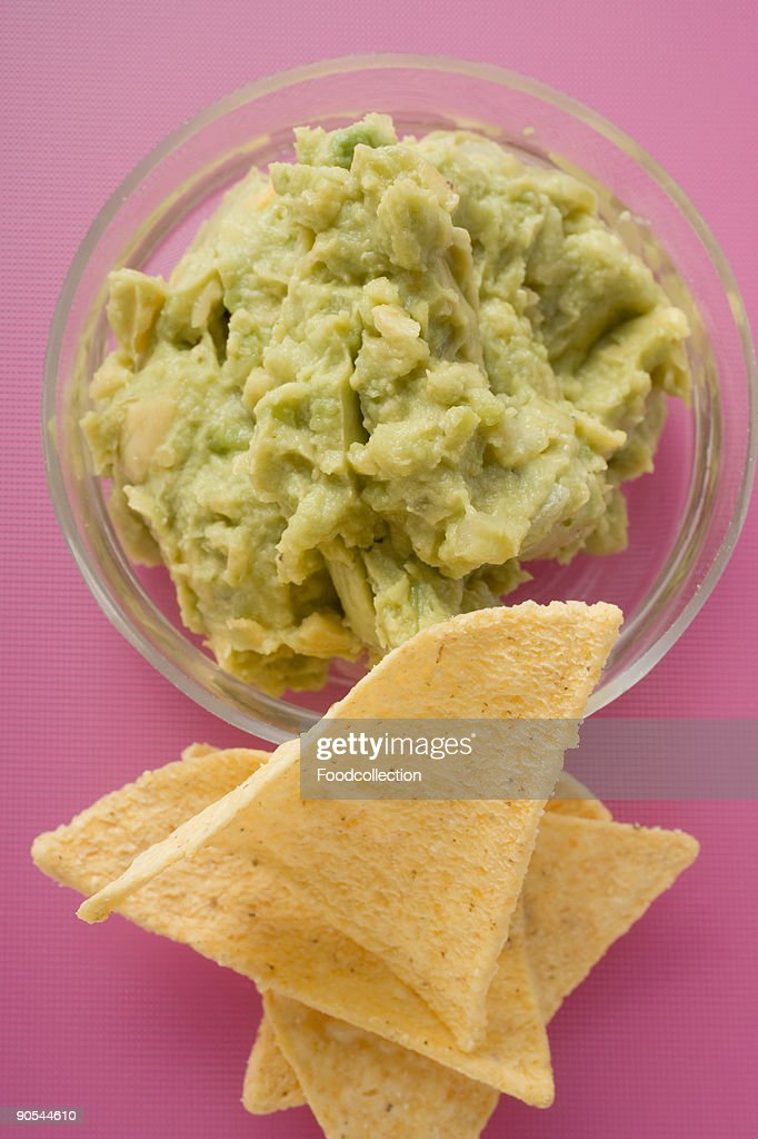 Guacamole with tortilla chips, close up : Stock Photo