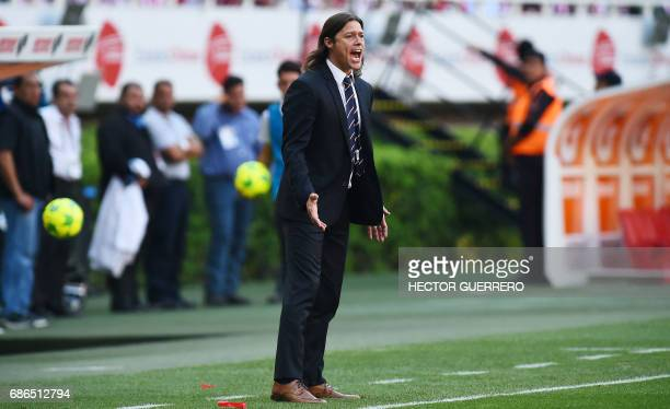 Guadalajara coach Matias Almeyda gives instructions to his players during their Mexican Clausura 2017 tournament semifinal football match against...