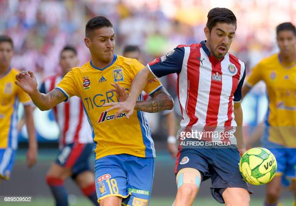 Guadalajara player Rodolfo Pizarro vies for the ball with Tigres player Ismael Sosa during the final of the Mexican Clausura 2017 football tournament...
