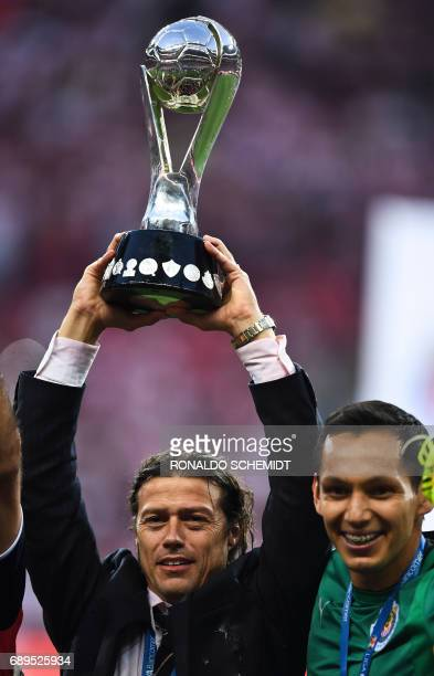 Guadalajara´s coach Matias Almeida and goalkeeper Rodolfo Cota celebrate with the trophy the victory against Tigres during the final match of the...
