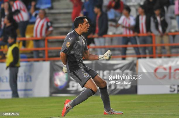 Guadalajara's goalie Rodolfo Cota celebrates his team's goal against Pachuca during their Mexican Apertura tournament football match on September 9...