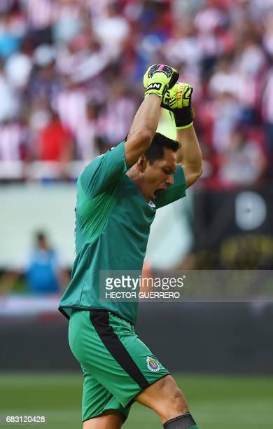 Guadalajara's goalkeeper Rodolfo Cota celebrates after his team scored against Atlas during the second leg quarterfinal football match of the Mexican...