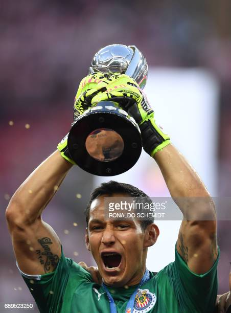 Guadalajara´s goalkeeper Rodolfo Cota celebrates with the trophy the victory against Tigres during the final match of the Mexican Clausura 2017...
