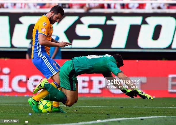 Guadalajara´s goalkeeper Rodolfo Cota vies for the ball with AndrePierre Gignac of Tigres during the final of the Mexican Clausura 2017 football...