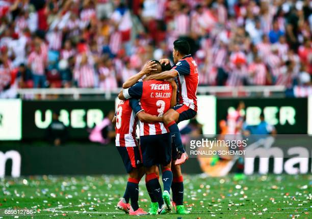 Guadalajara´s players celebrate a goal against Tigres during the final of the Mexican Clausura 2017 football tournament at the Chivas stadium in...