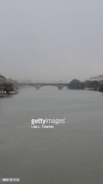 Guadalquivir river and Triana bridge on a foggy day