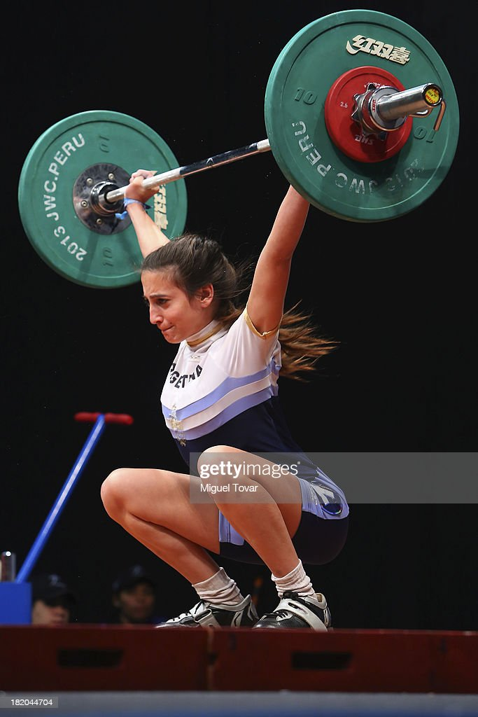 Guadalupe Silva of Argentina competes in women's 48 kg as part of the I ODESUR South American Youth Games at Coliseo Miguel Grau on September 27, 2013 in Lima, Peru.