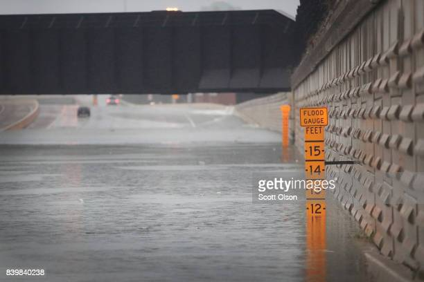 A guage shows the depth of water a an underpass on Interstate 10 which has been inundated with flooding from Hurricane Harvey on August 27 2017 in...