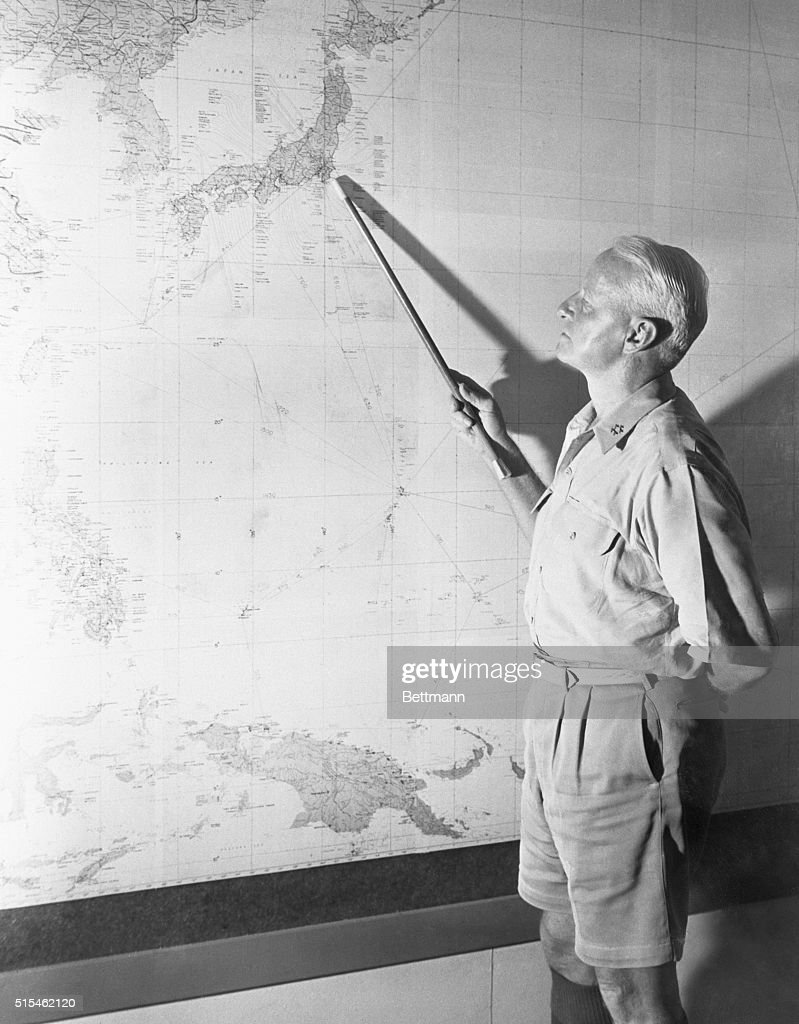 2/19/1945- Guam- Fleet Admiral Chester W. Nimitz, Commander in Chief of the Pacific Fleet and Pacific Ocean Areas, points to Tokyo on chart in his headquarters at Guam as he announces that carrier based planes of his fleet were attacking the Japanese cap