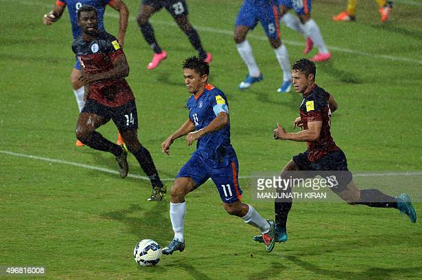 Guam players Ryan Guy and Brandon Marquee look on as Indian player Sunil Chhetri takes the ball during the the Asia Group D FIFA World Cup 2018...
