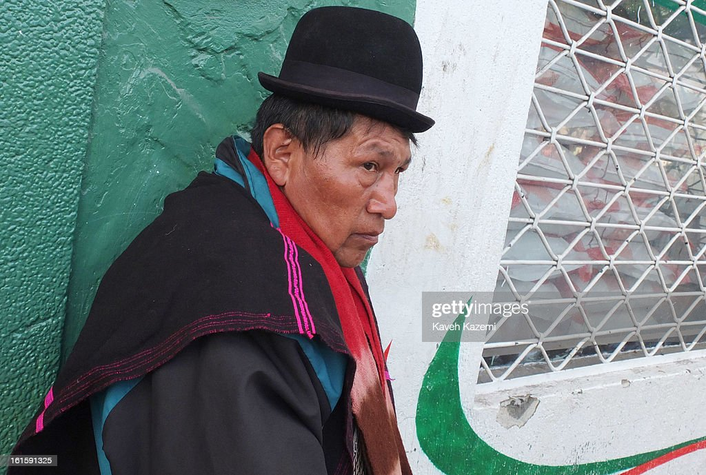 A Guambiano Indian stands in the Barrio Bolivar day market on January 23, 2013 in Popayan, Colombia.