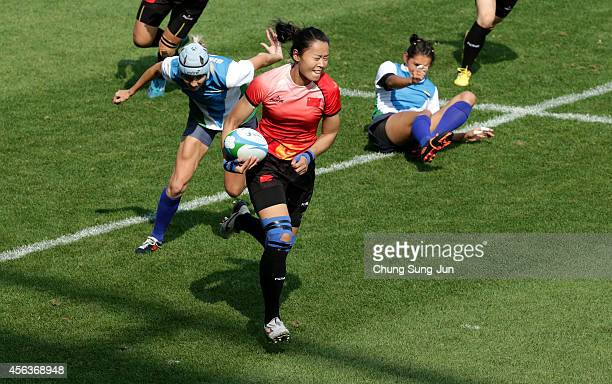 Guan Qishi of China in action in the Women's Rugby Preliminary Round Group B between China and Uzbekistan during day eleven of the 2014 Asian Games...