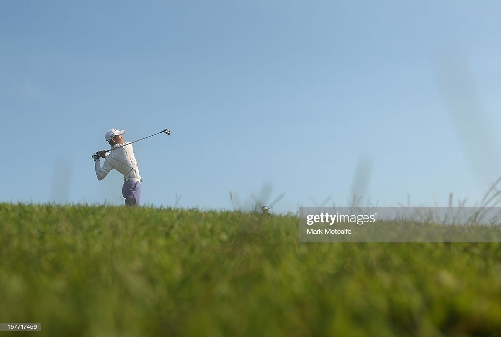 Guan Tianlang of China plays a shot during round one of the 2012 Australian Open at The Lakes Golf Club on December 6, 2012 in Sydney, Australia.