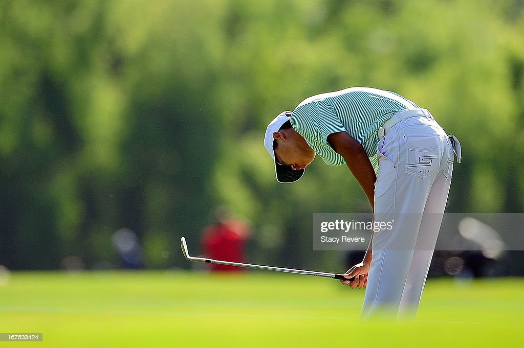 <a gi-track='captionPersonalityLinkClicked' href=/galleries/search?phrase=Guan+Tianlang&family=editorial&specificpeople=10007702 ng-click='$event.stopPropagation()'>Guan Tianlang</a> of China reacts to an errant shot on the 11th green during the second round of the Zurich Classic of New Orleans at TPC Louisiana on April 26, 2013 in Avondale, Louisiana.