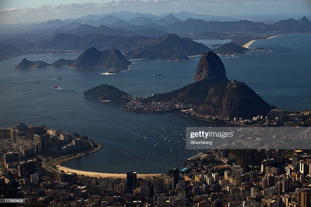 Guanabara Bay and Botafogo Beach are seen in this aerial photograph of Rio de Janeiro, Brazil, on Thursday, July 4, 2013. Brazils shorter-term swap rates fell after a report showed inflation slowed in June more than analysts forecast, damping speculation that the central bank will increase borrowing costs at a faster pace. Photographer: Dado Galdieri/Bloomberg via Getty Images