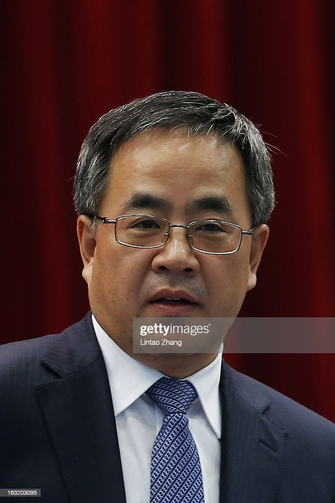 Guangdong Communist Party Secretary Hu Chunhua attends the Guangdong delegation's group meeting during the annual National People's Congress on March 6, 2013 in Beijing, China.Guangdong's gross domestic product (GDP) reached 5.7 trillion yuan in 2012.