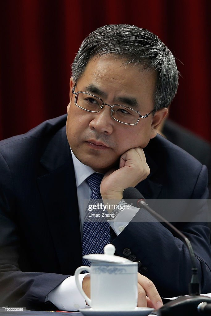 Guangdong Communist Party Secretary Hu Chunhua looks on during the Guangdong delegation's group meeting during the annual National People's Congress on March 6, 2013 in Beijing, China.Guangdong's gross domestic product (GDP) reached 5.7 trillion yuan in 2012.
