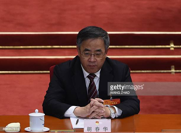 Guangdong provincial Party chief Hu Chunhua attends the closing of the 3rd Session of the 12th National People's Congress at the Great Hall of the...