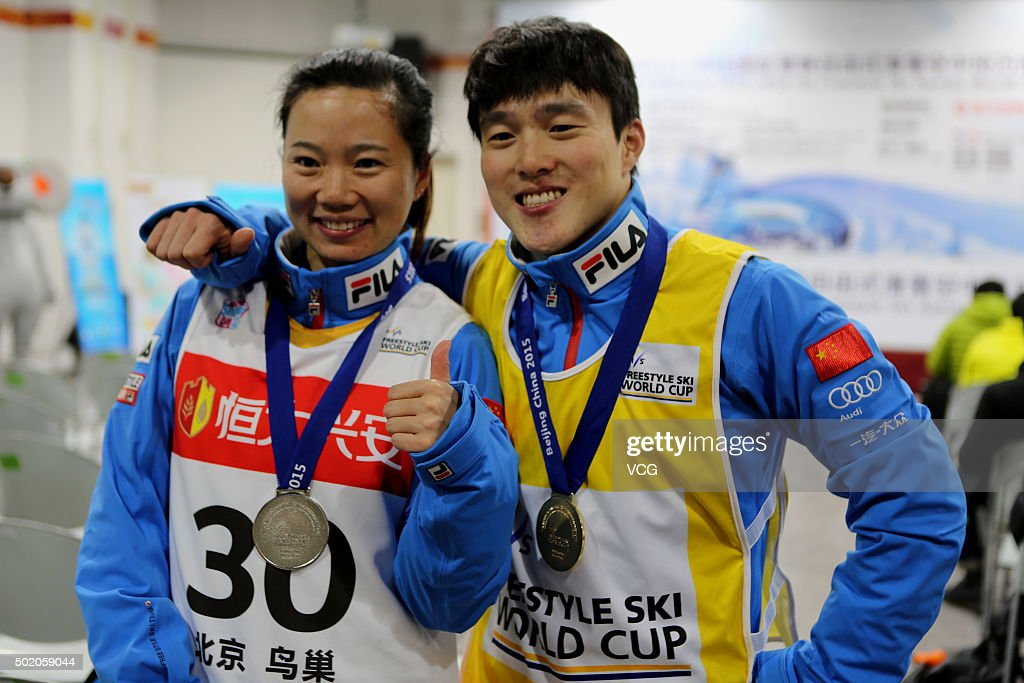 QI Guangpu of China wins the first place of the Men's Aerials match, and <a gi-track='captionPersonalityLinkClicked' href=/galleries/search?phrase=Zhang+Xin+-+Freestyle+Skier&family=editorial&specificpeople=12072778 ng-click='$event.stopPropagation()'>Zhang Xin</a> of China wins the second place of Women's Aerials match during the 2015-2016 FIS Freestyle Ski Aerials World Cup at Birds Nest on December 19, 2015 in Beijing, China.