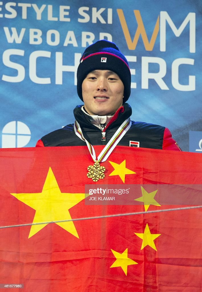 Guangpu Qi of China celebrates his victory at the podium of the Men's Aerials Finals during FIS Freestyle and Snowboarding World Ski Championships 2015 in Kreischberg, Austria on January 15, 2015.