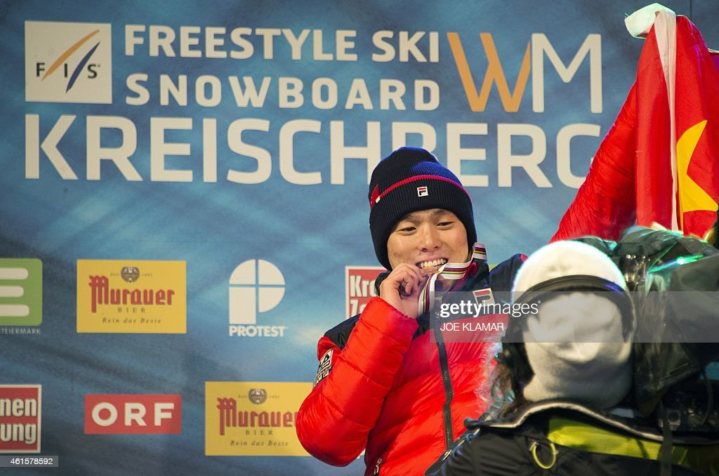 Guangpu Qi of China celebrates his victory at the podium of the Men's Aerials Finals during FIS Freestyle and Snowboarding World Ski Championships 2015 in Kreischberg on January 15, 2015. Guangpu Qi of China won gold medal ahead of the silver Alex Bowen of USA and bronze Maxim Gustik of Belarus.