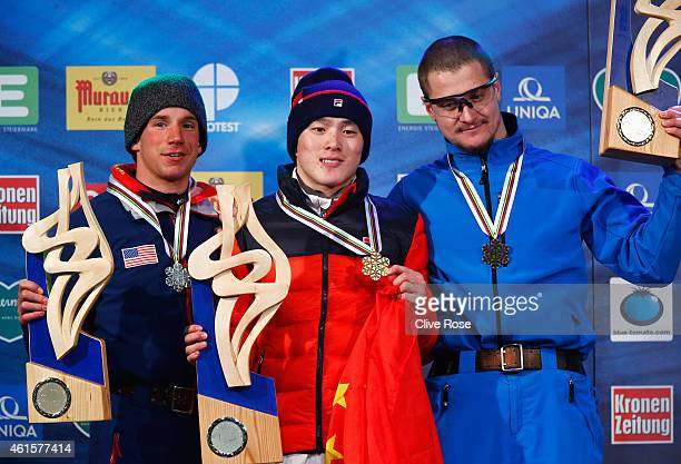 Guangpu Qi of China celebrates winning the gold medal with silver medallist Alex Bowen of USA and bronze medallist Maxim Gustik of Belarus during the...