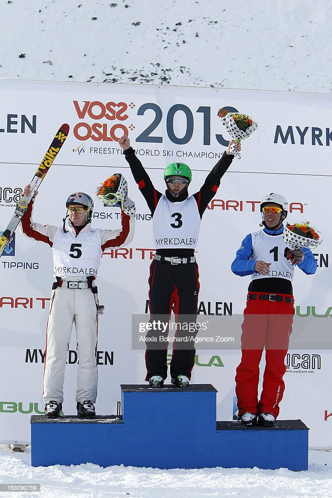 Guangpu Qi of China takes first place, Travis Gerrits of Canada takes second place, Zongyang Jia of China takes third place during the FIS Freestyle Ski World Championship Men's and Women's Aerials on March 07, 2013 in Voss, Norway.