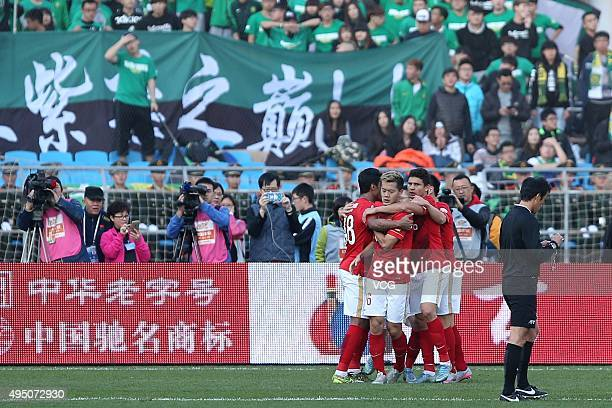 Guangzhou Evergrande celebrate in the match between Beijing Guoan and Guangzhou Evergrande during the China Super League 2015 at Beijing Workers'...