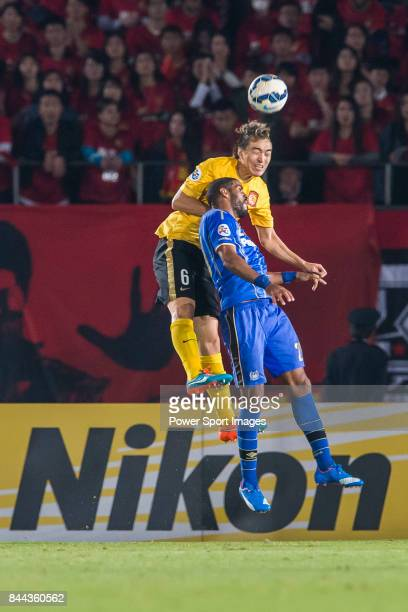 Guangzhou Evergrande defender Feng Xiaoting fights for the ball with Gamba Osaka forward Anderson Patric Aguiar Oliveira during the 2015 AFC...