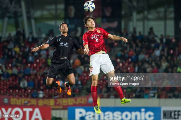Guangzhou Evergrande defender Feng Xiaoting fights for the ball with Seongnam FC forward Ricardo Bueno Da Silva during the 2015 AFC Champions League...
