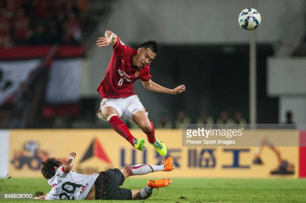 Guangzhou Evergrande defender Feng Xiaoting fights for the ball with FC Seoul midfielder Lee Sanghyeob during AFC Champions League Group Stage H...