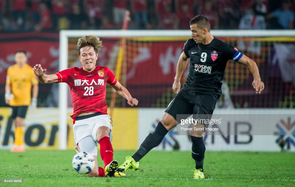 Guangzhou Evergrande defender Kim Young Gwon (L) fights for the ball with Al Ahli forward Rodrigo Jose Lima Dos Santos (R) during the AFC Champions League Final Match 2nd Leg match between Guangzhou Evergrande vs Al Ahli on 21 November 2015 at the Tianhe Sport Center in Guangzhou, China.