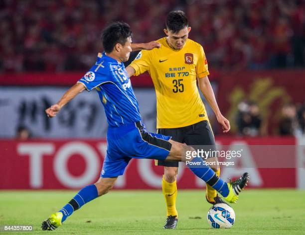 Guangzhou Evergrande defender Li Xuepeng fights for the ball with Gamba Osaka defender Konno Yasuyuki during the 2015 AFC Champions League Semi Final...
