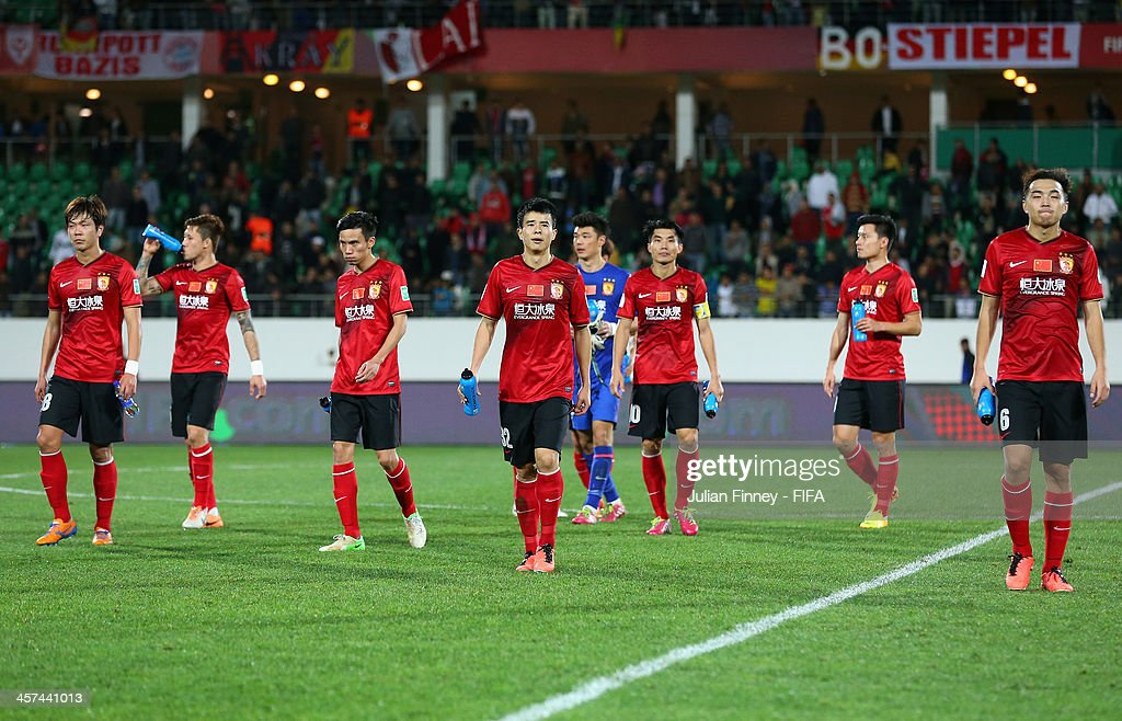 Guangzhou Evergrande FC players walk off the pitch after the FIFA Club World Cup Semi Final match between Guangzhou Evergrande FC and Bayern Muenchen at the Agadir Stadium on December 17, 2013 in Agadir, Morocco.