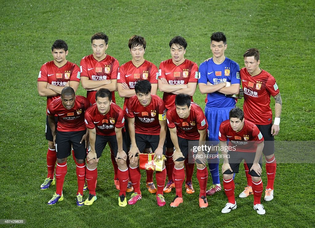 Guangzhou Evergrande FC's team group together before the start of their FIFA Club World Cup football semi-final match against Bayern Munich's, in the coastal Moroccan city of Agadir on December 17, 2013. The regional champions from each of the FIFA regions are gathering in the north African country of Morocco to decide which is the best domestic team in the world.