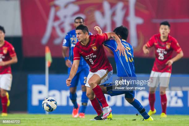 Guangzhou Evergrande forward Elkeson De Oliveira Cardoso fights for the ball with Gamba Osaka defender Konno Yasuyuki during the AFC Champions League...