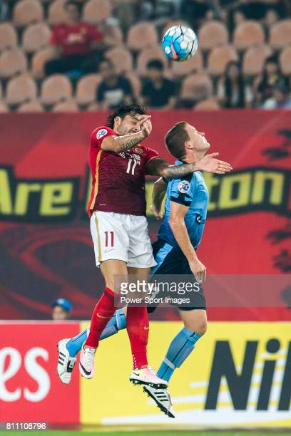Guangzhou Evergrande forward Ricardo Goulart fights for the ball with Sydney FC midfielder Brandon O'neill during the AFC Champions League 2016 Group...