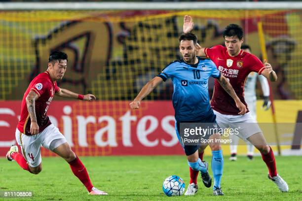 Guangzhou Evergrande forward Xu Xin fights for the ball with Sydney FC midfielder Milos Ninkovic during the AFC Champions League 2016 Group Stage...