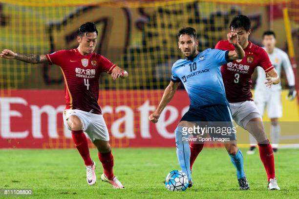 /Guangzhou Evergrande forward Xu Xin Sydney FC midfielder Milos Ninkovic and Guangzhou Evergrande defender Mei Fang compete for the ball during the...