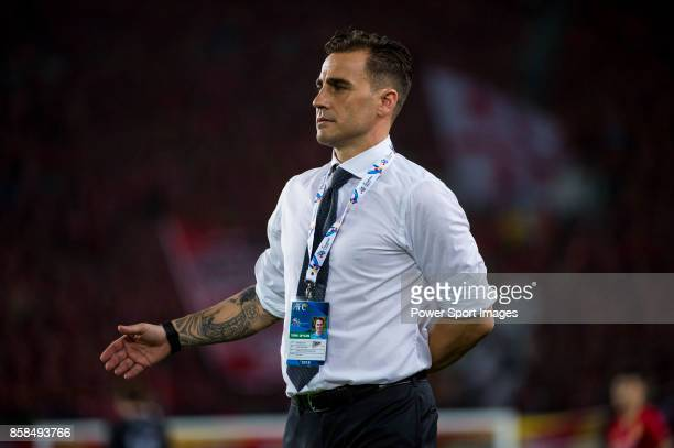 Guangzhou Evergrande head coach Fabio Cannavaro gestures during the AFC Champions League 2015 2nd Leg match between Guangzhou Evergrande and Seongnam...