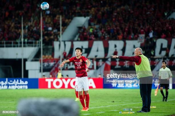 Guangzhou Evergrande Head Coach Luiz Felipe Scolari talks to Guangzhou Defender Zou Zheng during the AFC Champions League 2017 Group G match between...