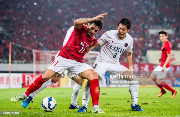 Guangzhou Evergrande midfielder Goulart Pereira fights for the ball with Kashima Antlers defender Shoji Gen during the AFC Champions League 2015...