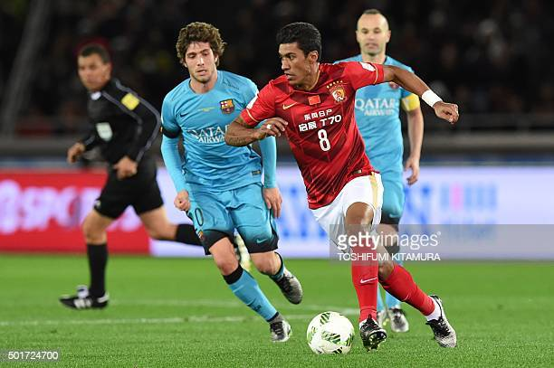Guangzhou Evergrande midfielder Paulinho controls the ball against Barcelona during their Club World Cup semifinal football match in Yokohama on...