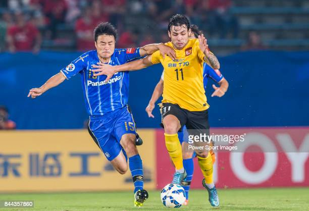 Guangzhou Evergrande midfielder Ricardo Goulart fights for the ball with Gamba Osaka defender Konno Yasuyuki during the 2015 AFC Champions League...
