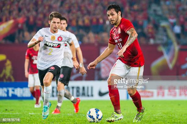 Guangzhou Evergrande midfielder Ricardo Goulart Pereira fights for the ball with Western Sydney Wanderers defender Shannon Cole during the AFC...