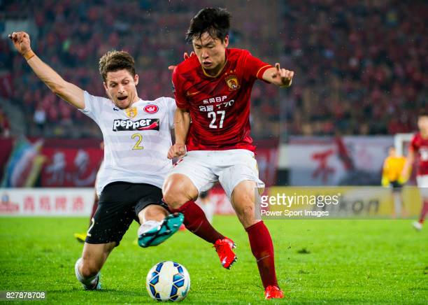 Guangzhou Evergrande midfielder Zheng Long fights for the ball with Western Sydney Wanderers defender Shannon Cole during the AFC Champions League...