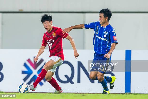Guangzhou Evergrande midfielder Zheng Long fights for the ball with Gamba Osaka defender Konno Yasuyuki during the AFC Champions League 2015 Semi...