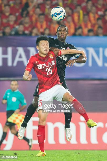 Guangzhou Evergrande midfielder Zou Zheng fights for the ball with Al Ahli forward Ahmed Khalil during the AFC Champions League Final Match 2nd Leg...