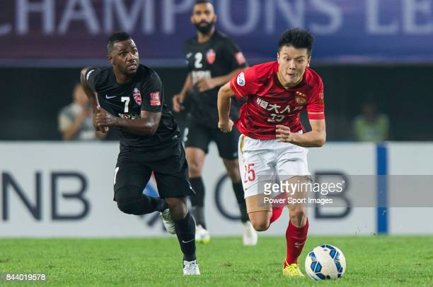 Guangzhou Evergrande midfielder Zou Zheng fights for the ball with Al Ahli forward Ismail Al Hammadi during the AFC Champions League Final Match 2nd...